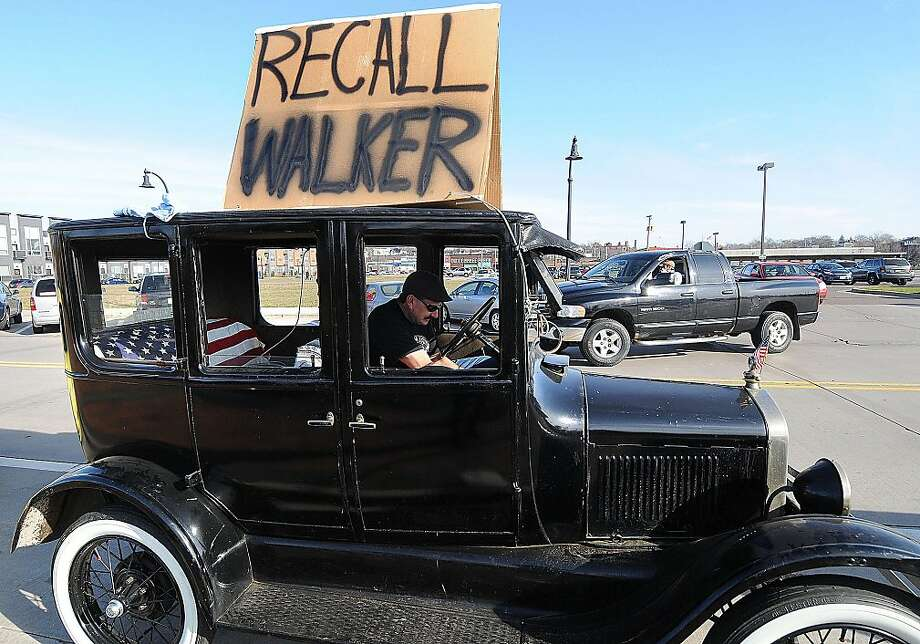 Brian Lawrence of Eau Claire, Wis. starts his 1927 Model T Ford Saturday, Nov. 12, 2011 as he left a rally at Phoenix Park in Eau Claire, Wis.  More than 300 persons turned out to hear Democratic speakers and to organize support for the campaign to recall Wisconsin Gov. Scott Walker. (AP Photo/Eau Claire Leader-Telegram, Steve Kinderman). Photo: Steve Kinderman, AP