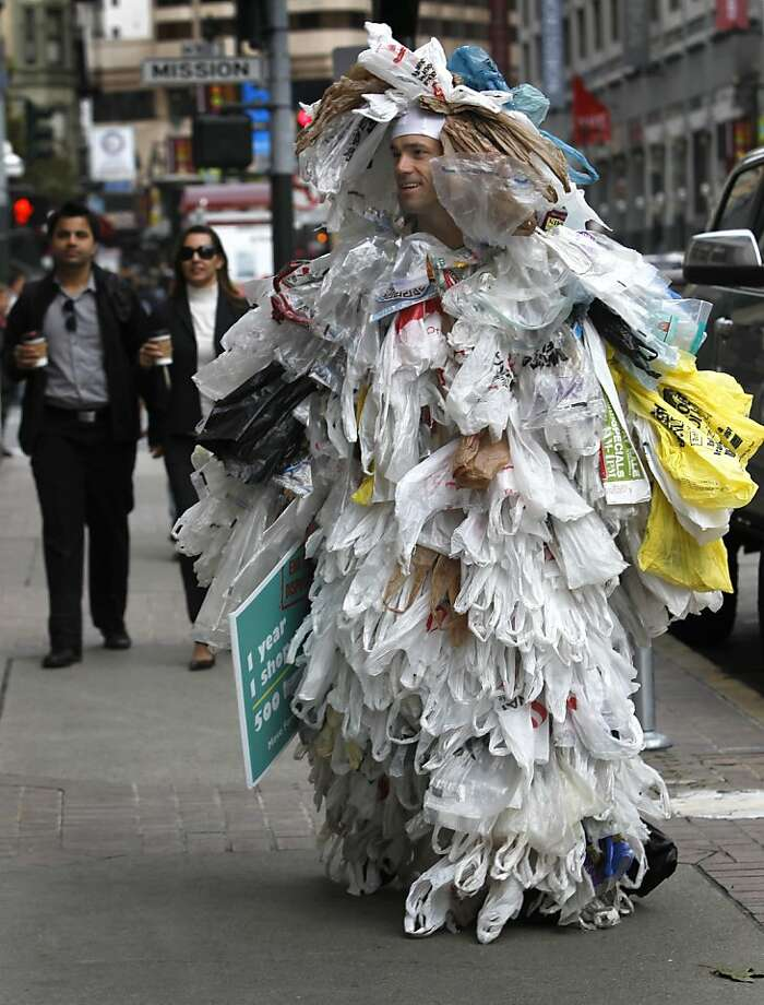 Andy Keller, founder and CEO of ChicoBag, walks through downtown San Francisco wearing a suit consisting of 500 plastic shopping bags on Friday, June 3, 2011. According to Keller, the average shopper uses as many as 500 plastic bags annually.  Ran on: 06-04-2011 ChicoBag CEO Andy Keller wears a suit made from 500 plastic bags. The founder of the company that makes reusable bags says an average shopper will use 500 plastic bags in a year. Photo: Paul Chinn, The Chronicle