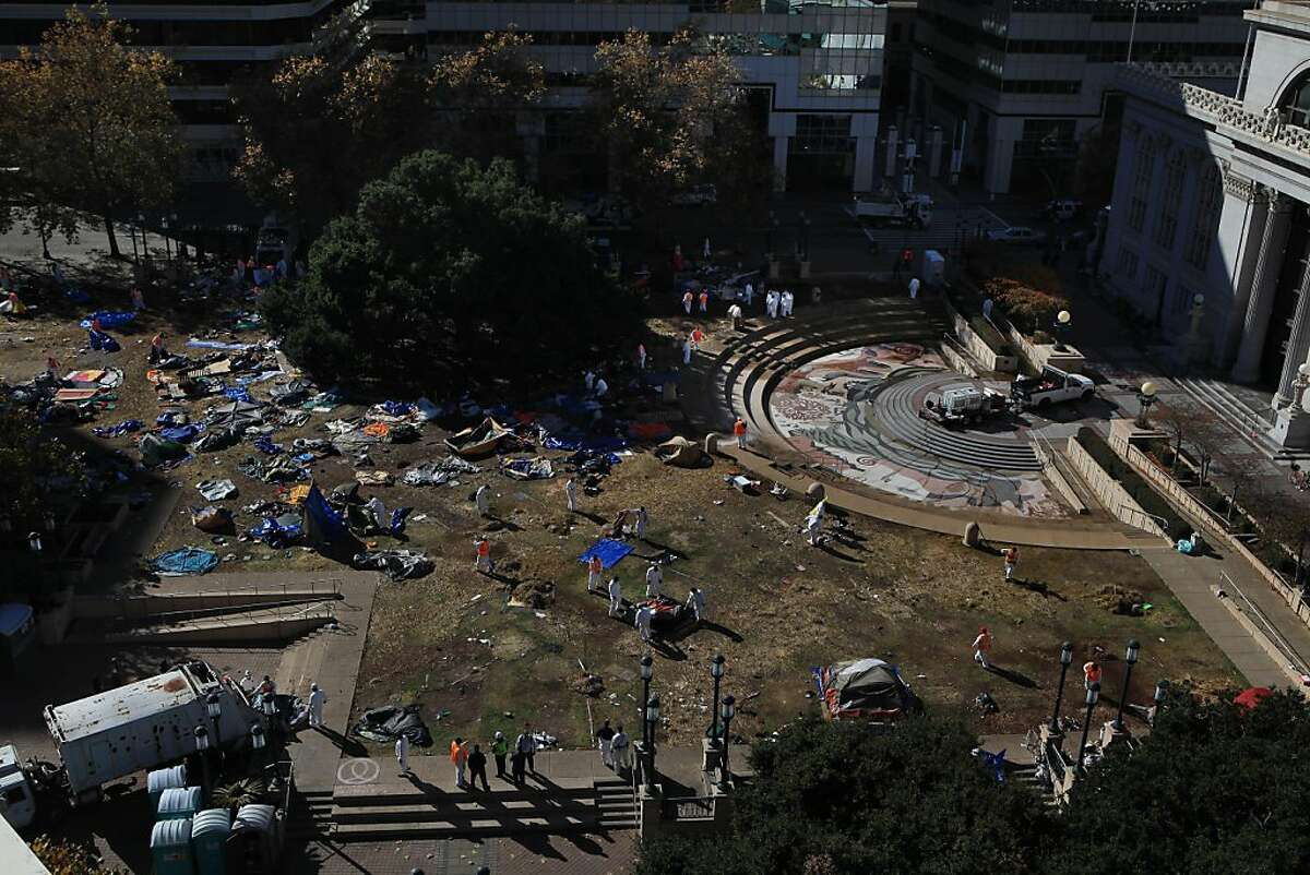 Pubic Works crews clean the Occupy Oakland camp at Frank Ogawa Plaza on Monday, November 14, 2011 in Oakland, Calif.