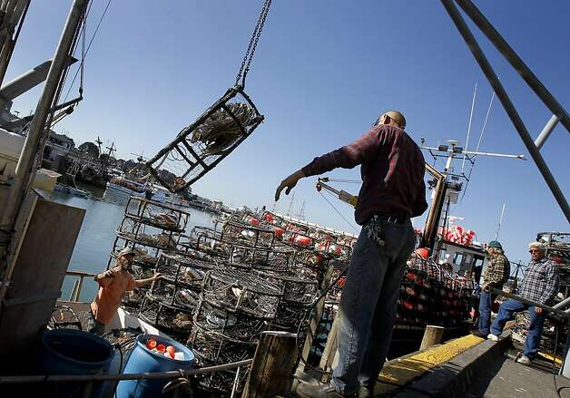 Bill Welch (right) helps a fisherman load pots Monday November 14, 2011. All along the San Francisco waterfront, crab fisherman are waiting for the word to begin setting their pots. Photo: Brant Ward, The Chronicle