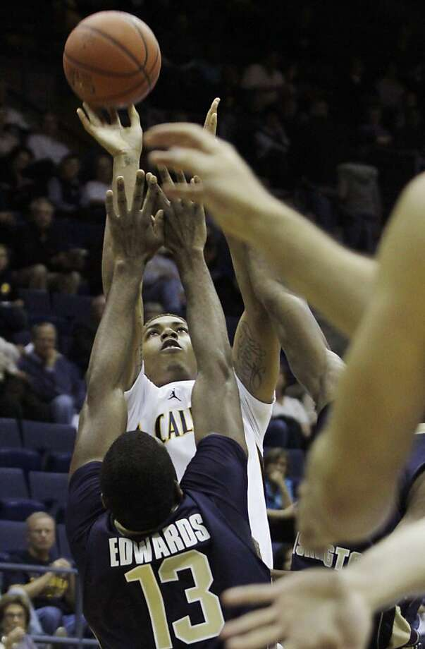 California's Justin Cobbs shoots over George Washington's Jabari Edwards (13) during the first half of an NCAA college basketball game in the CBE Classic, Sunday, Nov. 13, 2011 in Berkeley, Calif. (AP Photo/George Nikitin)  Ran on: 11-14-2011 Cal guard Justin Cobbs, who scored 16 points, shoots over George Washington's Jabari Edwards during the first half. Ran on: 11-14-2011 Cal guard Justin Cobbs, who scored 16 points, shoots over George Washington's Jabari Edwards during the first half. Photo: George Nikitin, AP