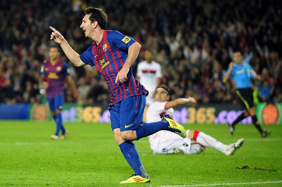 FC Barcelona's Lionel Messi, from Argentina, left, reacts after scoring his third goal against Mallorca during a Spanish La Liga soccer match at the Camp Nou stadium in Barcelona, Spain, Saturday, Oct. 29, 2011. (AP Photo/Manu Fernandez) Photo: Manu Fernandez, AP