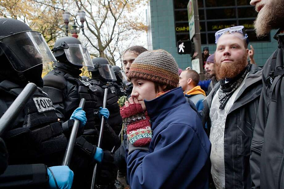 PORTLAND - NOVEMBER 13: A protester pleads with police during a demonstration near the Occupy Portland encampment November 13, 2011 in Portland, Oregon. Portland police have reclaimed the two parks in which occupiers have been camping after a night of brinksmanship with protesting crowds of several thousands. (Photo by Natalie Behring/Getty Images) Photo: Natalie Behring, Getty Images
