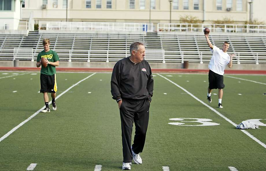 Former college and NFL football coach Roger Theder trains middle school and high school athletes like Andrew Olson (left) and Brian Gehring (right) at Laney College football field in Oakland, Calif. on Saturday Nov. 5, 2011. Photo: Tim Maloney, The Chronicle