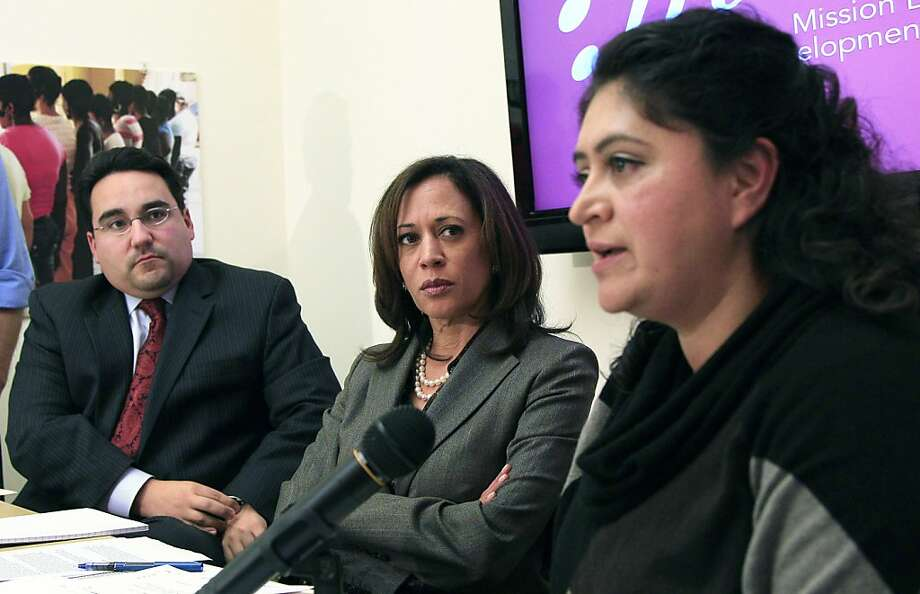 California Attorney General Kamala Harris, center, and Michael Troncoso, Senior Counsel to the Attorney General, left, listen as mortgage fraud victim Jacqueline Marcelos speaks at a roundtable of foreclosure victims at Mission Economic Development Agency in San Francisco, on Monday, Nov. 21, 2011. (AP Photo/Jeff Chiu) Photo: Jeff Chiu, AP