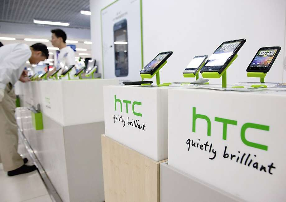 A customer looks at HTC Corp. mobile phones at a shopping mall in Shanghai, China, on Wednesday, July 6, 2011. HTC Corp., Asia's second-largest smartphone maker, posted sales that beat analysts' estimates for a third quarter and said growth will continue as demand in the U.S. and Asia remain strong. Photographer: Kevin Lee/Bloomberg  Ran on: 07-07-2011 HTC Corp., Asia's second-largest smart-phone maker, will pay $300 million cash for S3 Graphics of Fremont. Photo: Kevin Lee, Bloomberg