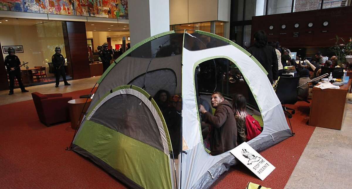 Protesters brough a tent into the building as they occupy the Bank of America at 50 California street and wait to placed under arrested and taken away, as hundreds of people made up of Occupy SF members and local University students marched through the financial district on Wednesday November 16, 2011 in San Francisco, Ca.