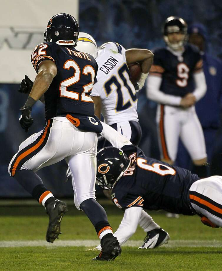 In this Sunday, Nov. 20, 2011 photo, Chicago Bears quarterback Jay Cutler, right, falls to the ground slowing San Diego Chargers cornerback Antoine Cason after Cason intercepted a Cutler pass in the fourth quarter of an NFL football game in Chicago. Also chasing on the play is  Matt Forte (22).  Bears coach Lovie Smith says Cutler suffered a broken thumb on his right throwing hand during their 31-20 win against the Chargers. He says it happened when Cutler helped tackle Antoine Cason on an interception return in the fourth quarter.  (AP Photo/Charles Rex Arbogast)  Ran on: 11-22-2011 Bears quarterback Jay Cutler (6) breaks his thumb while trying to tackle Chargers cornerback Andre Cason (20). Ran on: 11-22-2011 Bears quarterback Jay Cutler (6) breaks his thumb while trying to tackle Chargers cornerback Andre Cason (20). Photo: Charles Rex Arbogast, AP