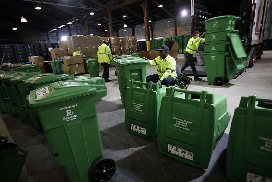 Marcus Tiger, center, Alfredo Guzman, right, and Maurice Lige, left, assemble compost bins and get them ready for delivery at the transfer station in San Francisco, Calif., Monday, November 21, 2011.  Recology is about to hit one million tons of compost since they began in 1996.   Ran on: 11-22-2011 Recology workers Maurice Lige (left), Marcus Tiger and Alfredo Guzman assemble compost bins for delivery at the transfer station in S.F. The firm expects to hit the 1-million-ton mark with collections today. Photo: Sarah Rice, Special To The Chronicle