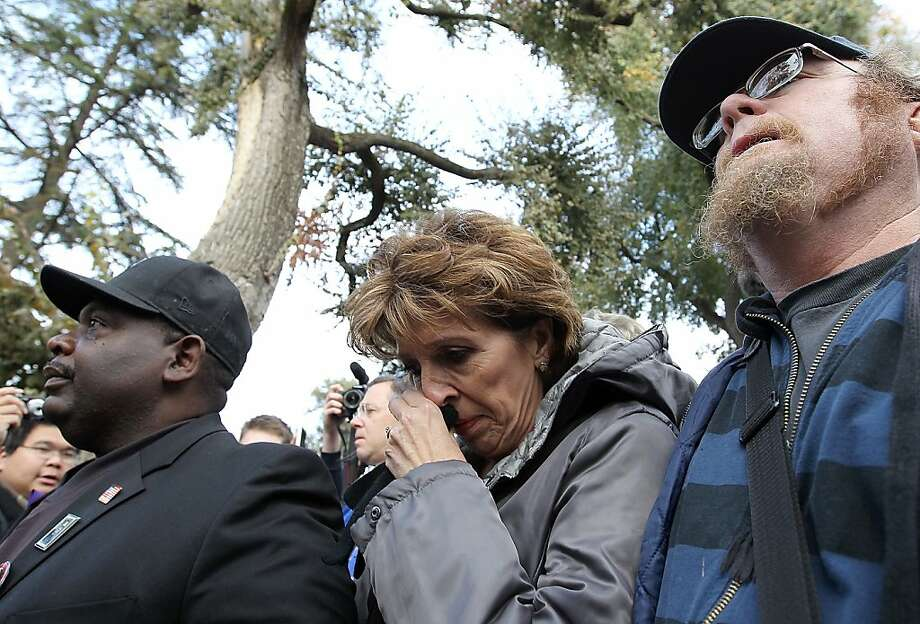DAVIS, CA - NOVEMBER 21:  UC Davis Chancellor Linda Katehi (C) wipes her eye as she is escorted to a car after speaking to Occupy protestors during a demonstration at the UC Davis campus on November 21, 2011 in Davis, California. Thousands of Occupy protestors staged a demonstration on the UC Davis campus to protest the UC Davis police who pepper sprayed students who sat passively with their arms locked during an Occupy Wall Street demonstration on November 18.  (Photo by Justin Sullivan/Getty Images) Photo: Justin Sullivan, Getty Images