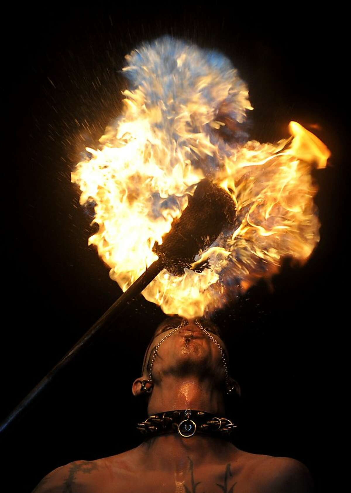 A man spits fire during the
