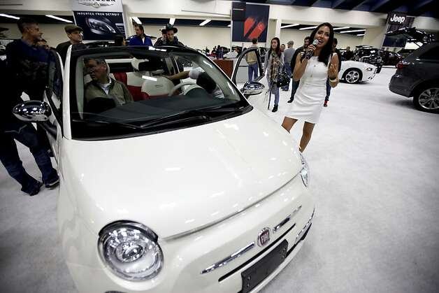 Catherine, a spokesperson for Fiat, presents the 2012 Fiat 500 at the 54th Annual International Auto Show at the Moscone Center in San Francisco, Calif. on Sunday Nov. 20, 2011. Photo: Tim Maloney, The Chronicle