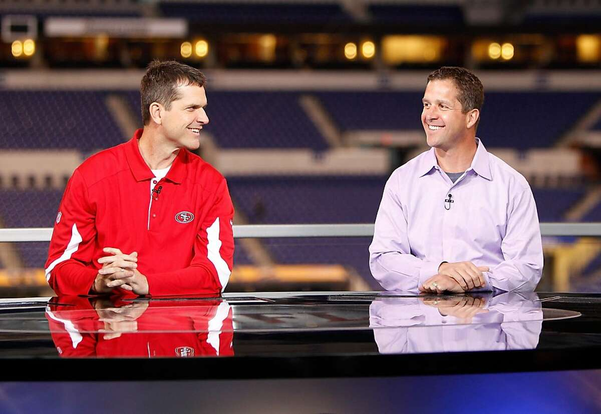 San Francisco head coach Jim Harbaugh and brother Baltimore Ravens head coach John Harbaugh on the NFL Network set during the 2011 NFL Scouting Combine at Lucas Oil Stadium on Feb. 24 in Indianapolis, Ind. (AP Photo/Ben Liebenberg)