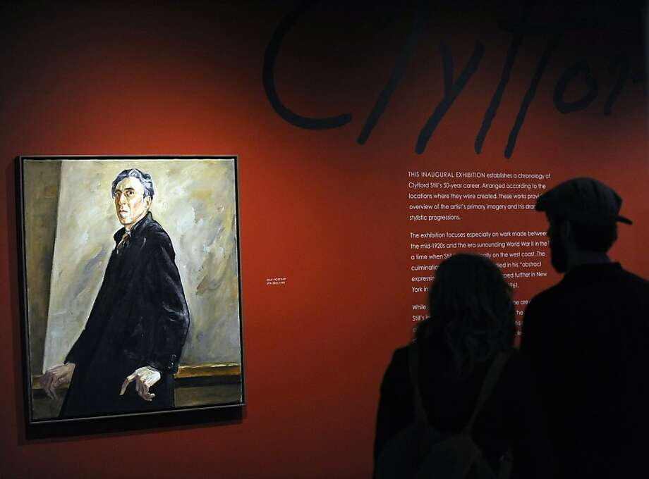 Art goers enjoy a self-portrait painted by abstract expressionist artist, Clyfford Still, (1904-1980) at the new Clyfford Still Museum Friday, Nov. 18, 2011 in Denver.  The museum opened its doors Friday morning ahead of a sold out opening celebration in the evening. (AP Photo/The Denver Post, Andy Cross)  MANDATORY CREDIT; MAGS OUT; TV OUT   Ran on: 11-22-2011 A selfportrait painted by Abstract Expressionist Clyfford Still, a leading Bay Area artist, figures prominently at the new Clyfford Still Museum in Denver. Ran on: 11-22-2011 A selfportrait painted by Abstract Expressionist Clyfford Still, a leading Bay Area artist, figures prominently at the new Clyfford Still Museum in Denver. Ran on: 11-22-2011 A selfportrait painted by Abstract Expressionist Clyfford Still, a leading Bay Area artist, figures prominently at the new Clyfford Still Museum in Denver. Photo: Andy Cross, AP