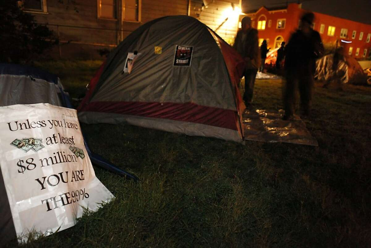 Protesters set up tents for a new Occupy Oakland camp at 18th and Linden Streets. A small group of about 30 Occupy Oakland protesters set up camp at a vacant lot at the corner of 18th and Linden Streets in Oakland, Calif., on Monday night, November 21, 2011. They expect more to join them.
