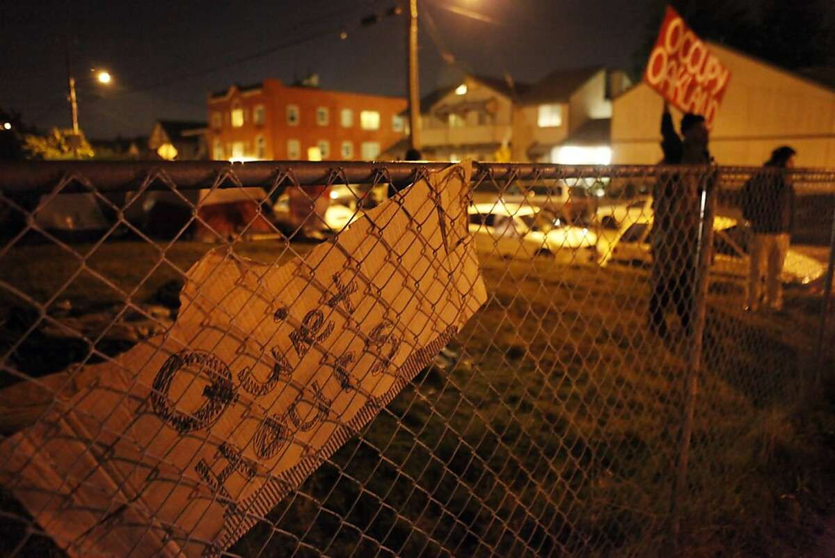 A small group of about 30 Occupy Oakland protesters set up camp at a vacant lot at the corner of 18th and Linden Streets in Oakland, Calif., on Monday night, November 21, 2011. They expect more to join them.