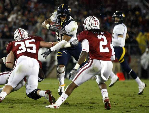University of California Ise Sofele hurdles Stanford Cardinal players in the 114th annual Big Game in Stanford California Saturday November 19, 2011  Ran on: 11-20-2011 Cal running back Isi Sofele tries to slip the tackle attempt of Stanford's Jarek Lancaster (35). Photo: Lance Iversen, The Chronicle