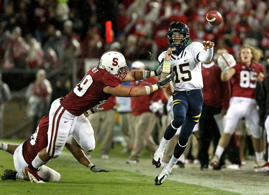 University of California Zach Maynard completes a twenty five yard pass before he was push out of bounds in the second quarter against the Stanford Cardinal in the annual 114th Big Game in Stanford California Saturday November 19, 2011  Ran on: 11-20-2011 Bears quarterback Zach Maynard gets off a pass under pressure in the second quarter. It went for a  19-yard gain. Photo: Lance Iversen, The Chronicle