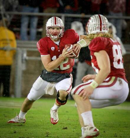 Stanford quarterback Andrew Luck runs with the ball during the Cal vs. Stanford football game in Stanford, Calif., on Saturday, November 19, 2011. Photo: John Storey, Special To The Chronicle