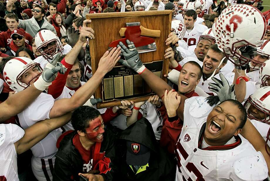 Stanford celebrates the recovery of the Stanford Ax after their win over the Cal Bears 48-14 in the 113th Big Game, at Memorial Stadium in Berkeley, Calif, on Friday Nov. 19, 2010.     Ran on: 11-21-2010 The Axe, swarmed by a happy group from Stanford, is headed to Palo Alto for only the second time in nine years. Ran on: 11-21-2010 The Axe, swarmed by a happy group from Stanford, is headed to Palo Alto for only the second time in nine years. Photo: Michael Macor, The Chronicle