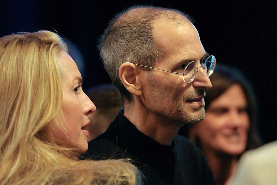 Steve Jobs, chief executive officer of Apple Inc., right, greets members of the audience with his wife Laurene Powell Jobs after unveiling the iCloud storage system at the Apple Worldwide Developers Conference 2011 in San Francisco, California, U.S., on Monday, June 6, 2011. Apple is using iCloud to retain its dominance in the smartphone and tablet markets amid fresh competition from devices powered by Google Inc.'s Android software. Photographer: David Paul Morris/Bloomberg Steve Jobs, chief executive officer of Apple Inc., right, greets members of the audience with his wife Laurene Powell Jobs after unveiling the iCloud storage system at the Apple Worldwide Developers Conference 2011 in San Francisco, California, U.S., on Monday, June 6, 2011. Apple is using iCloud to retain its dominance in the smartphone and tablet markets amid fresh competition from devices powered by Google Inc.'s Android software. Photographer: David Paul Morris/Bloomberg *** Local Caption *** Laurene Powell Jobs; Steve Jobs Photo: David Paul Morris, Bloomberg