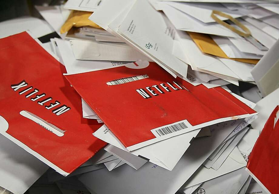 SAN FRANCISCO - FILE:  Red Netflix envelopes sit in a bin of mail at the U.S. Post Office sort center  March 30, 2010 in San Francisco, California.  It was reported that at the closing bell today Netflix will release its third quarter financial performance report in addition to it's announcement that it will be expanding business to Great Britain and Ireland october 24, 2011.  (Photo by Justin Sullivan/Getty Images)  Ran on: 10-25-2011 The number of Netflix customers with mail subscriptions is dwindling the company may lose millions this quarter. Photo: Justin Sullivan, Getty Images