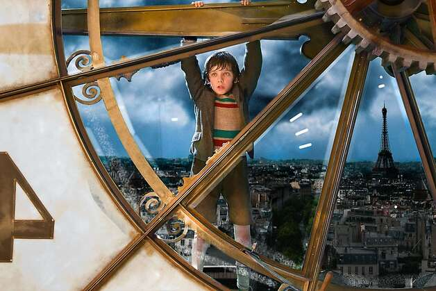 Asa Butterfield plays Hugo Cabret in HUGO, from Paramount Pictures and GK Films.    Ran on: 11-23-2011 Asa Butterfield and Chloe Grace Moretz with the automaton in &quo;Hugo.&quo; Photo: Jaap Buitendijk, Paramount Pictures