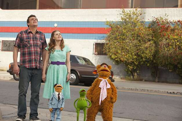 """THE MUPPETS""  UP AND AWAY Ð Kermit, Fozzie Bear, are joined by Gary (JASON SEGEL) and Mary (AMY ADAMS) and new Muppet, Walter, as they search for their old friend The Great Gonzo, who is nowÑbelieve it or notÑa plumbing magnate. Will their plans go down the drain? Find out in THE MUPPETS (Opening in theatres on November 23rd).  Photograph by: Scott Garfield  ©Disney Enterprises, Inc. All Rights Reserved. Photo: Scott Garfield, Disney Enterprises, Inc."