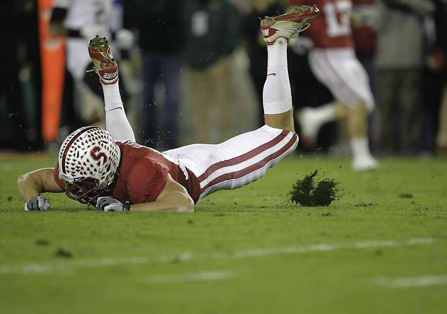 Stanford's Coby Fleener, looses his footing as he kicks up a chunk of turf, as the Stanford Cardinal go on to fall to the Oregon Ducks 53-30 at Stanford Stadium, on Saturday November 12, 2011 in Palo Alto, Ca. Photo: Michael Macor, The Chronicle