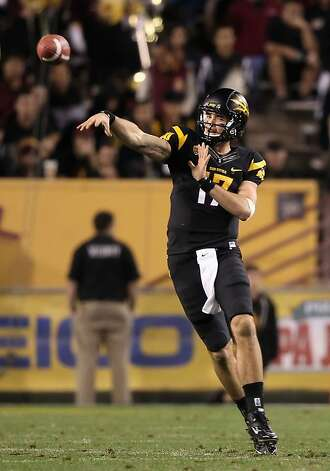 TEMPE, AZ - NOVEMBER 19:  Quarterback Brock Osweiler #17 of the Arizona State Sun Devils throws a pass during the college football game against the Arizona Wildcats at Sun Devil Stadium on November 19, 2011 in Tempe, Arizona. The Wildcats defeated the Sun Devils 31-27. (Photo by Christian Petersen/Getty Images) Photo: Christian Petersen, Getty Images