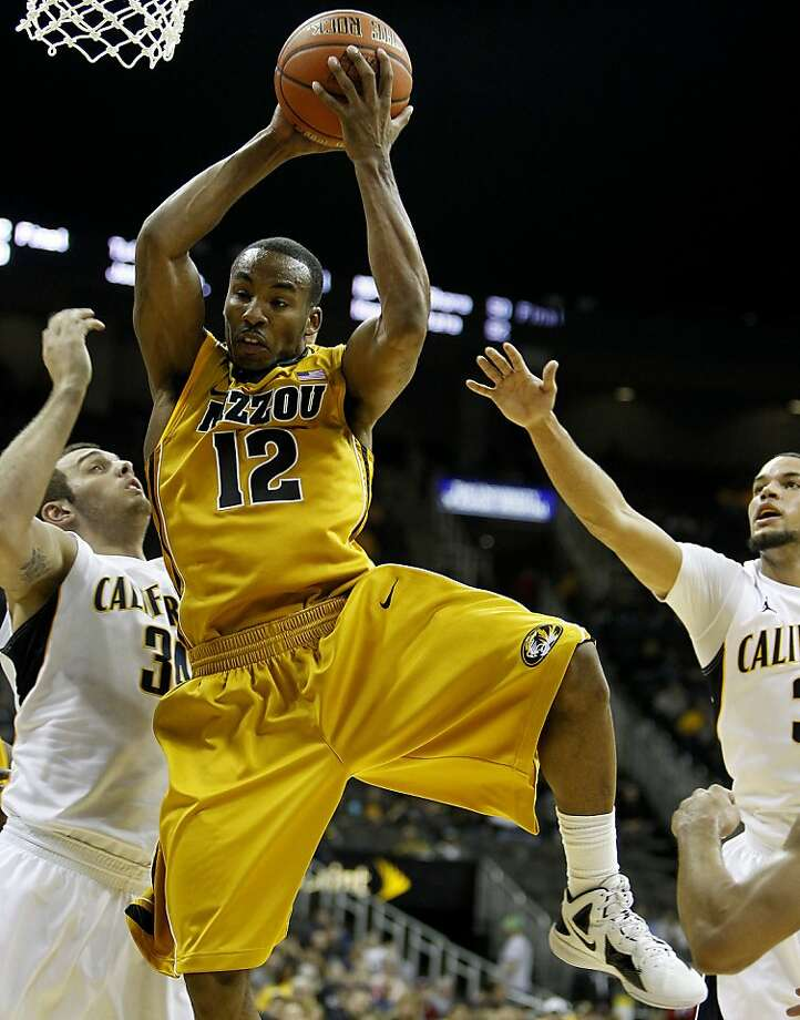 Missouri's Marcus Denmon rips down a rebound against California during the second half of the CBE Classic championship game at the Sprint Center in Kansas City, Missouri, Tuesday, November 22, 2011. Missouri won, 92-53. (Rich Sugg/Kansas City Star/MCT) Photo: Rich Sugg, MCT