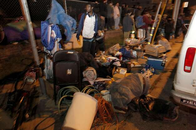 Belongings were moved to the sidewalk, as Oakland police gave the occupy Oakland protesters minutes to vacate the lot at the corner of Linden and 18th streets  in Oakland, Ca., on Tuesday November 22, 2011. Photo: Michael Macor, The Chronicle