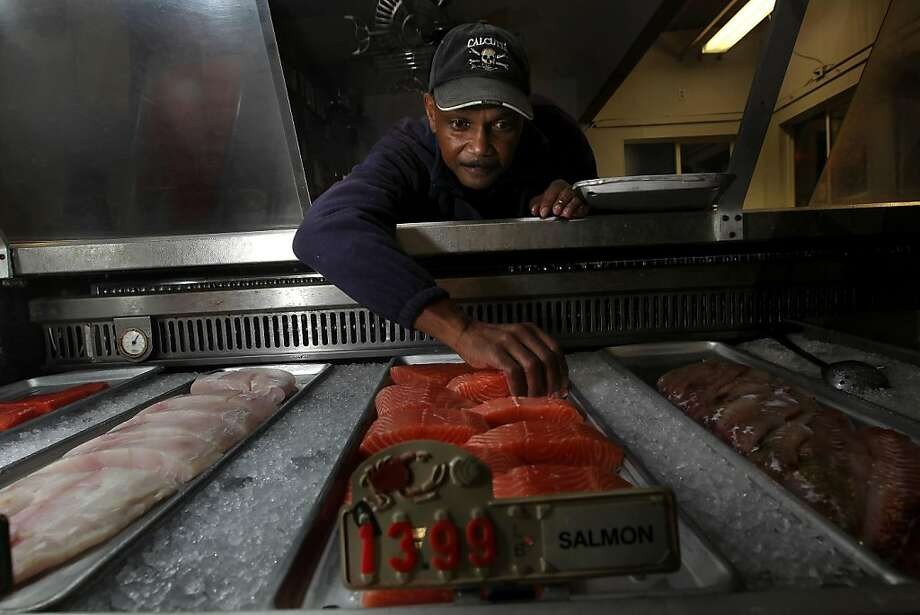 Mel Judson, arranges the display case at Western Boat and Tackle, which is usually filled with crab meat this time at the tackle shop in San Rafael, Ca., on Tuesday November 22, 2011. The shortage of Dungeness crab continues for the Thanksgiving holiday because negotiations between crabbers and buyers have failed. Photo: Michael Macor, The Chronicle