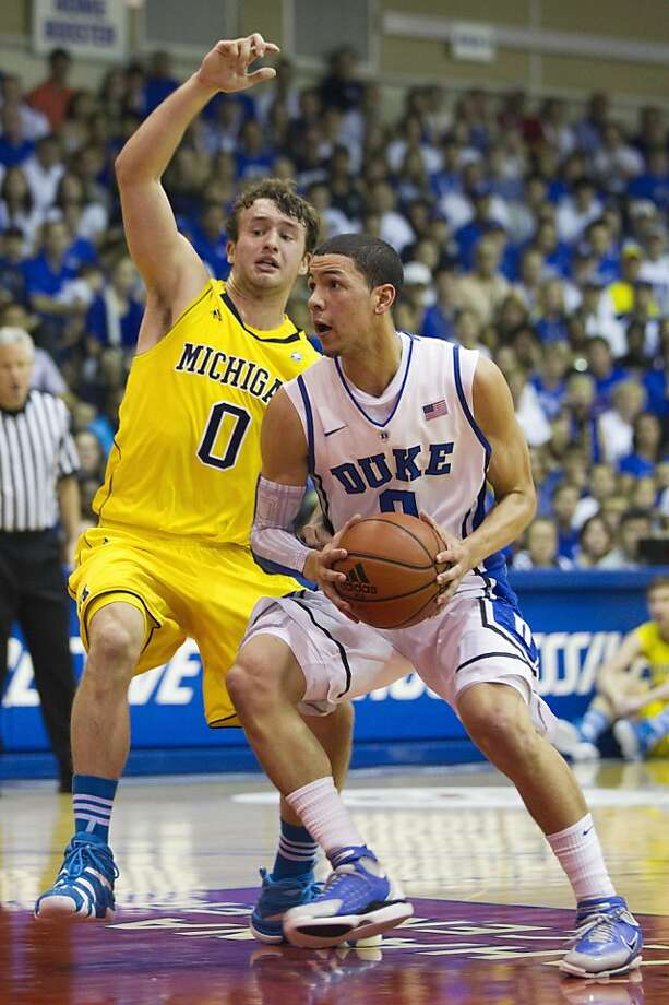 Michigan guard Zack Novak (0) attempts to cutoff Duke guard Austin Rivers (0) as Rivers drives down the lane in the first half of an NCAA college basketball game Tuesday, Nov. 22, 2011, in Lahaina, Hawaii.  (AP Photo/Eugene Tanner)  Ran on: 11-23-2011 In an 0-0 matchup, Duke's Austin Rivers tries to get past Michigan's Zack Novak. Rivers scored 20 points. Ran on: 11-23-2011 In an 0-0 matchup, Duke's Austin Rivers tries to get past Michigan's Zack Novak. Rivers scored 20 points as the Blue Devils prevailed. Photo: Eugene Tanner, AP