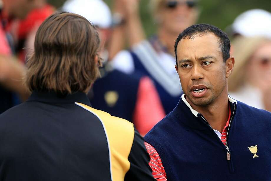 MELBOURNE, AUSTRALIA - NOVEMBER 20:  (L-R) Aaron Baddeley of the International Team and Tiger Woods of the U.S. Team shake hands after finishing their match on the15th hole during the Day Four Singles Matches of the 2011 Presidents Cup at Royal Melbourne Golf Course on November 20, 2011 in Melbourne, Australia.  (Photo by Scott Halleran/Getty Images) Photo: Scott Halleran, Getty Images