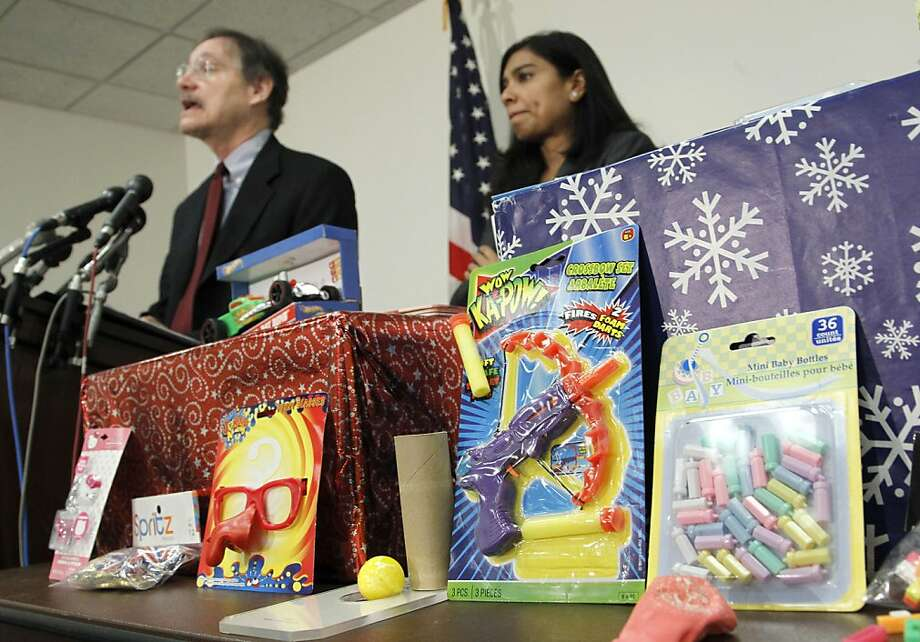 Robert Adler of the Consumer Products Safety Commission and Nasima Hossain of the US Public Interest Research Group (PIRG) take part in a news conference on dangerous or toxic toys, Tuesday, Nov. 22, 2011, on Capitol Hill inWashington. Photo: Pablo Martinez Monsivais, AP