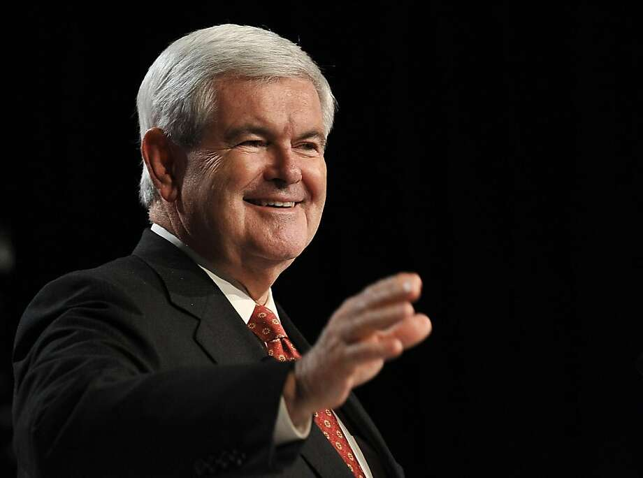 (FILES) US Republican presidential hopeful former House Speaker Newt Gingrich waves before addressing the Family Research Council's Values Voter Summit in Washington, DC in this October 7, 2011 file photo.  Former House Speaker Newt Gingrich is the latest Republican to claim the title of frontrunner in the topsy-turvy 2012 presidential nomination race, according to a new poll on November 22,2011. The Quinnipiac University survey of party faithful showed Gingrich pulling decisively ahead of former Massachusetts governor Mitt Romney, by a commanding ten points, 49 percent versus 39 percent. When the entire field of Republican hopefuls is taken in account, the former congressman from Georgia leads with a still impressive 26 percent support, compared to 22 percent for Romney. AFP PHOTO/Nicholas KAMM (Photo credit should read NICHOLAS KAMM/AFP/Getty Images) Photo: Nicholas Kamm, AFP/Getty Images