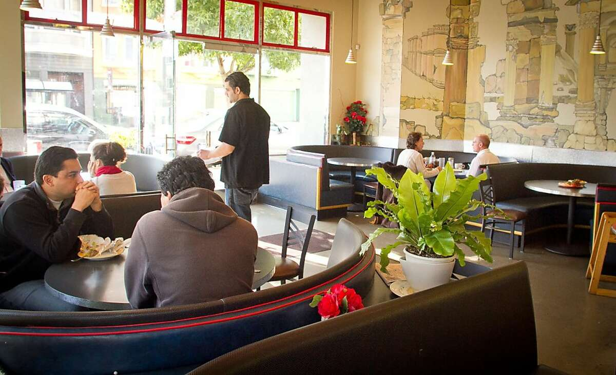 Diners enjoy lunch at Palmyra restaurant in San Francisco, Calif., on Wednesday, November 16, 2011.