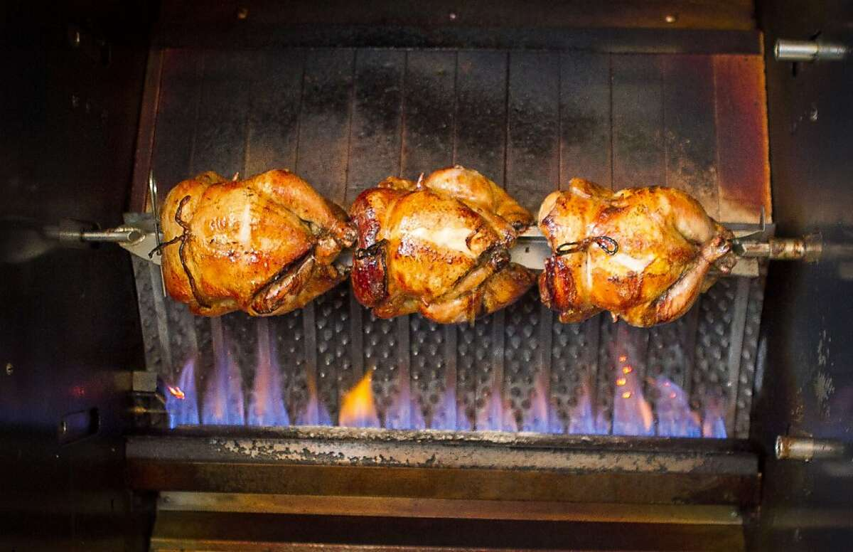 Chickens roasting in the rotisserie at Palmyra restaurant in San Francisco, Calif., on Wednesday, November 16, 2011.