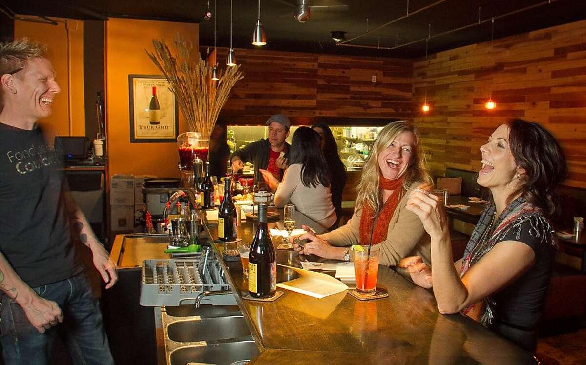 Bartender Dave Mur talks with customers at Fondue Cowboy in San Francisco, Calif., on Thursday, November 10, 2011.