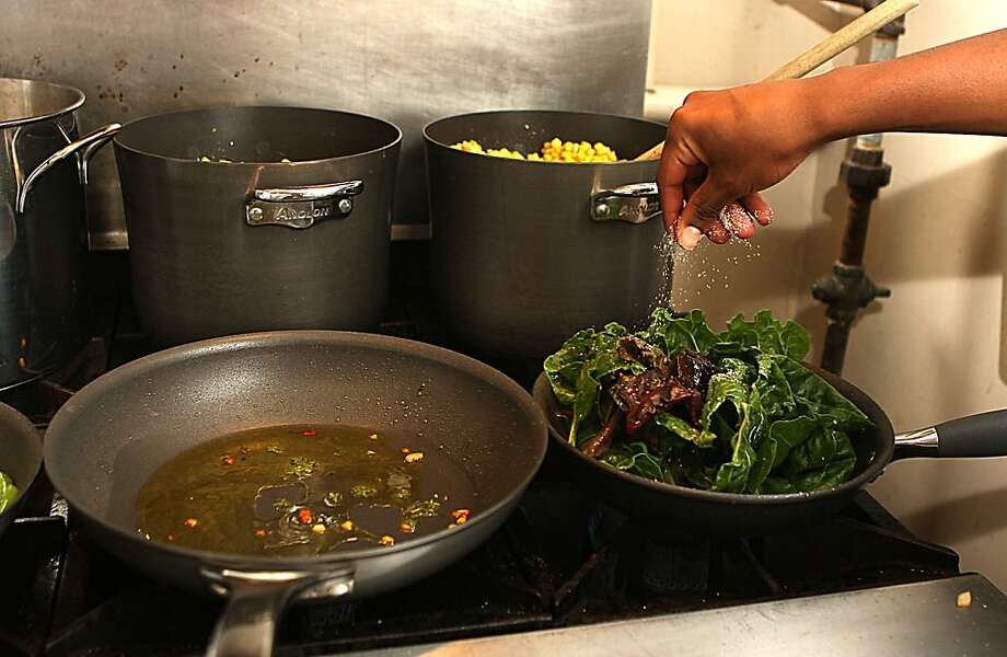 Vegetables being sauteed on new cookware at Ida B. Wells high school in San Francisco, Calif., on Tuesday, November 22, 2011.  Ida B. Wells high school has the only culinary program offered in the San Francisco public  high school district and had just received $5000 dollars worth of new cookware. Photo: Liz Hafalia, The Chronicle