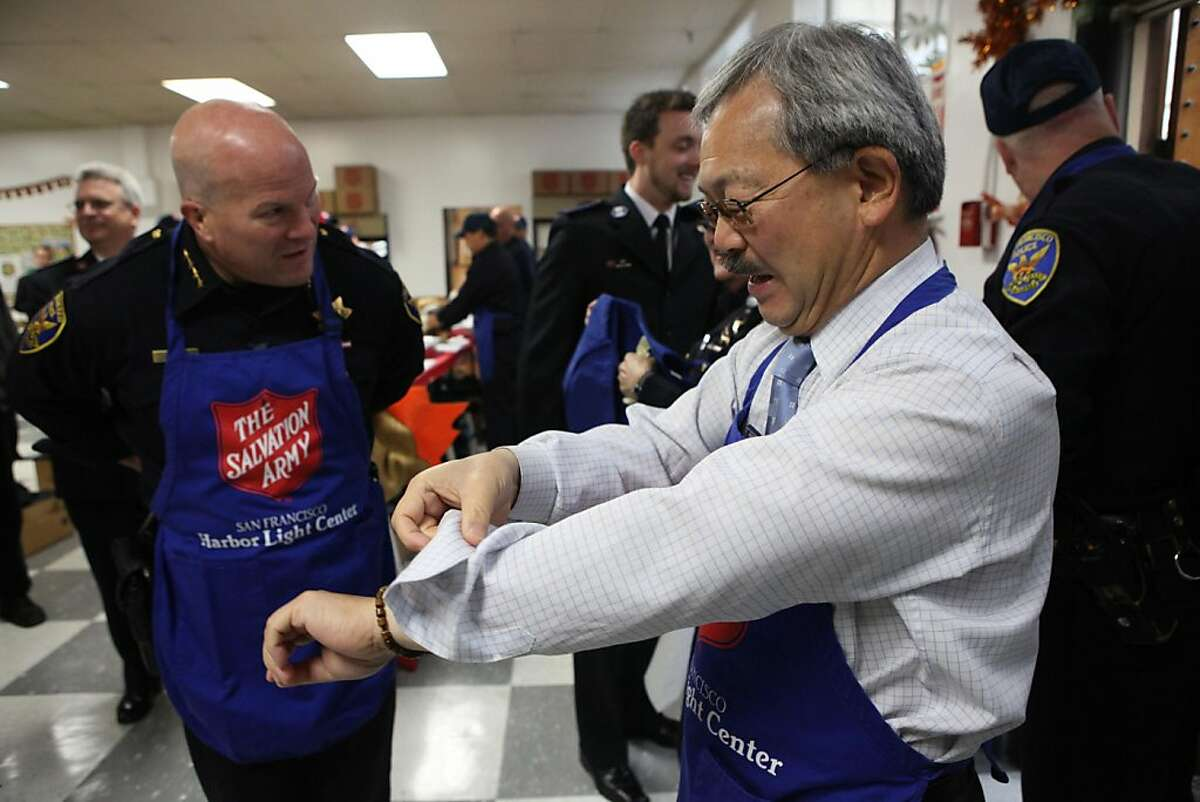 SF Police Chief Greg Suhr (left) and Mayor Ed Lee (right) at the Salvation Army getting ready to carve turkeys in San Francisco, Calif., on Wednesday, November 23, 2011.