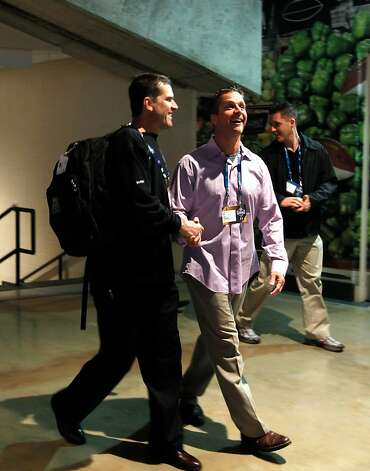 San Francisco head coach Jim Harbaugh walks with his brother Baltimore Ravens head coach John Harbaugh during the 2011 NFL Scouting Combine at Lucas Oil Stadium on Feb. 24 in Indianapolis, Ind. (AP Photo/Ben Liebenberg) Photo: Ben Liebenberg, ASSOCIATED PRESS