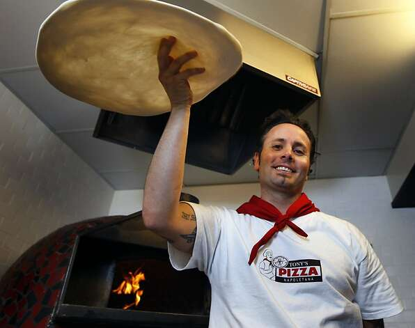 Tony Gemignani garnered national headlines a few years ago when he beat the Italians at pizza making, in Italy. He's now opened a restaurant in North Beach where he has four ovens and does four distinct styles of pizza.   Ran on: 09-06-2009 Tony Gemignani prepares four distinct styles of pizza in his four ovens at Tony's Pizza Napoletana in North Beach. Styles, clockwise from top left, include Italian, Napoletana, Sicilian and American. Photo: Lance Iversen, The Chronicle