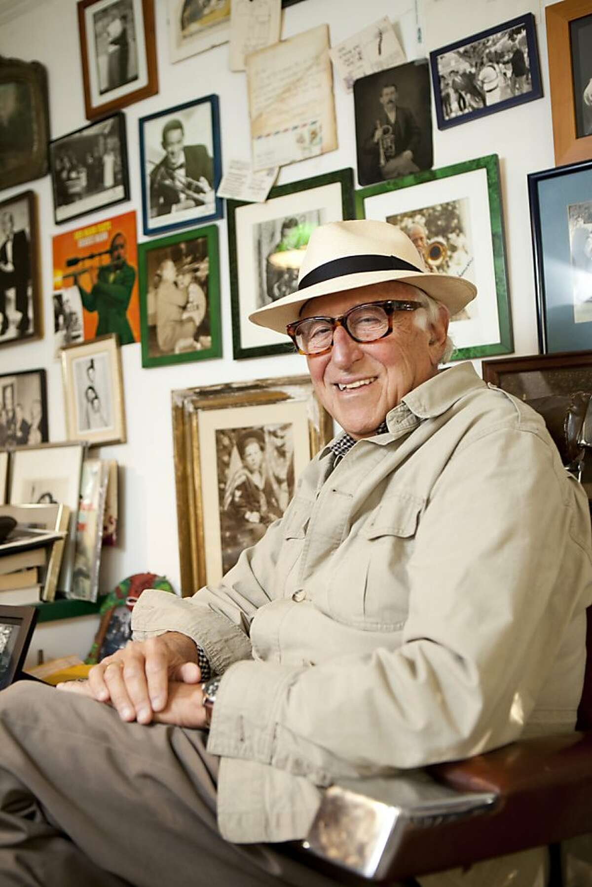 Radio humorist and jazz trombonist Mal Sharpe sits in his barber chair at his home against a collection of photographs of famous jazz trombonists in Berkeley, Calif. on Saturday Nov. 12, 2011.