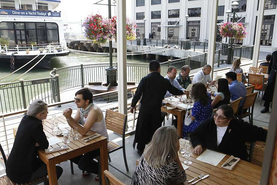 Dinners enjoy lunch and sun on the outside deck at The Plant Cafe Organic on Monday Aug. 10, 2009 in San Francisco, Calif.   Ran on: 08-23-2009 Dinners enjoy lunch and sunshine on the deck at the Plant Cafe Organic. Photo: Mike Kepka, The Chronicle