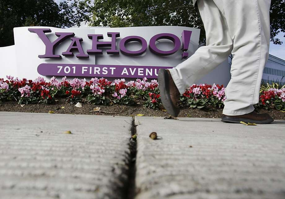 FILE - In this Dec. 1, 2010 file photo shows an employee leaves a Yahoo headquarters building in Sunnyvale, Calif. Carol Bartz was fired from Yahoo Monday after two and a half years as CEO. Tim Morse, the company's chief financial officer, was named interim CEO. (AP Photo/Paul Sakuma, File)  Ran on: 09-07-2011 Yahoo, with headquarters in Sunnyvale, has been struggling to stay relevant as an online giant despite its popular products and being used by more than 500 million people each month. Ran on: 09-07-2011 Yahoo, with headquarters in Sunnyvale, has been struggling to stay relevant as an online giant despite its popular products and being used by more than 500 million people each month. Photo: Paul Sakuma, AP