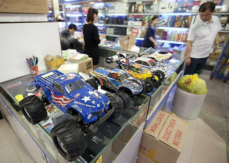 Remote controlled toy cars are displayed at a shop in the Futian district of Shenzhen, Guangdong Province, China, on Saturday, Nov. 19, 2011. The World Bank said China is heading for a soft landing of growth in excess of 8 percent next year, and with most Asian nations has fiscal scope to cushion its economy from an escalation in Europe's debt crisis. Photographer: Forbes Conrad/Bloomberg Photo: Forbes Conrad, Bloomberg
