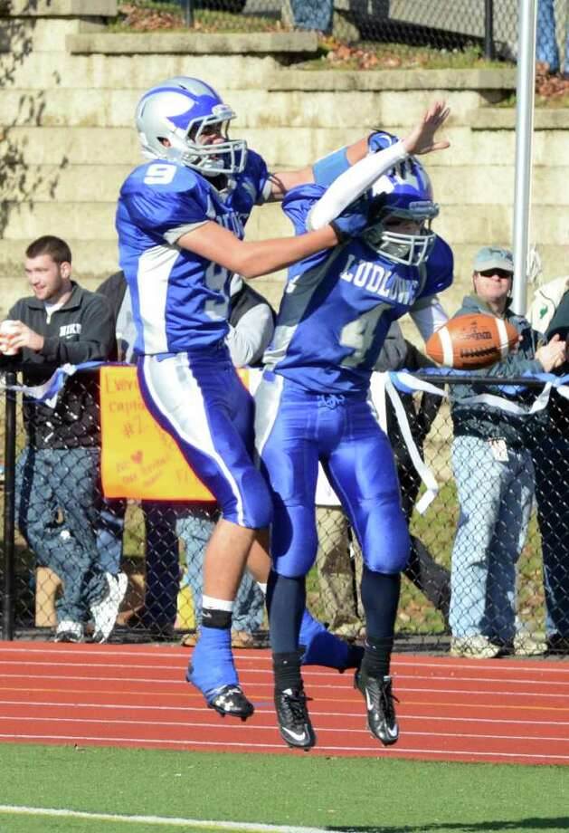 Fairfield Ludlowe's Stephen Zadravec (9) congratulates teammate Matthew White (4) on his touchdown during the Thanksgiving day football game against Fairfield Warde at Fairfield Ludlowe High School on Thursday, Nov. 24, 2011. Photo: Amy Mortensen / Connecticut Post Freelance