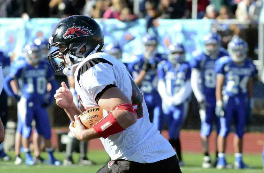 Fairfield Warde's Joe Marx (44) carries the ball during the Thanksgiving day football game against Fairfield Ludlowe at Fairfield Ludlowe High School on Thursday, Nov. 24, 2011. Photo: Amy Mortensen / Connecticut Post Freelance